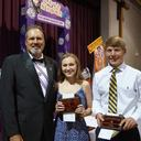 Mr. Steve Guidroz presenting the Knights of Columbus Council #11270 from Our Lady Queen of Angels Catholic Church Catholic Youth Leadership Awards to Mallory Fontenot and Sam Jarrell.